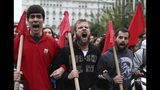 Protesters shout slogans during a rally in Athens, Sunday, Nov. 17, 2019. Several thousands people march to the U.S. Embassy in Athens under tight police security to commemorate a 1973 student uprising that was crushed by Greece's military junta, that ruled the country from 1967-74. (AP Photo/Yorgos Karahalis)