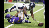Minnesota Vikings quarterback Kirk Cousins (8) fumbles as he is sacked by Denver Broncos defensive tackle Shelby Harris (96) during the first half of an NFL football game, Sunday, Nov. 17, 2019, in Minneapolis. The Broncos recovered the fumble. (AP Photo/Jim Mone)