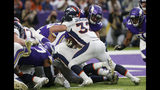 Denver Broncos fullback Andy Janovich (32) scores on a 1-yard touchdown run in front of Minnesota Vikings middle linebacker Eric Kendricks, right, during the first half of an NFL football game, Sunday, Nov. 17, 2019, in Minneapolis. (AP Photo/Jim Mone)