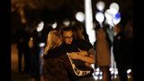 Students embrace during a vigil at Central Park in the aftermath of a shooting at Saugus High School Thursday, Nov. 14, 2019, in Santa Clarita, Calif. Los Angeles County sheriff's officials say a 16-year-old student shot five classmates and then himself in a quad area of Saugus High School Thursday morning. (AP Photo/Marcio Jose Sanchez)