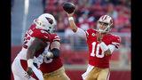 San Francisco 49ers quarterback Jimmy Garoppolo (10) passes against the Arizona Cardinals during the second half of an NFL football game in Santa Clara, Calif., Sunday, Nov. 17, 2019. (AP Photo/John Hefti)