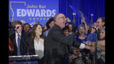 Louisiana Gov. John Bel Edwards arrives to address supporters at his election night watch party in Baton Rouge, La., Saturday, Nov. 16, 2019. (AP Photo/Matthew Hinton)