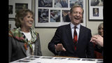 Democratic presidential candidate businessman Tom Steyer laughs with his wife, Kat Taylor, before filing to be placed on the New Hampshire primary ballot at the Statehouse, Tuesday, Nov. 12, 2019, in Concord, N.H. (AP Photo/Elise Amendola)