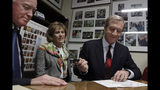 Democratic presidential candidate businessman Tom Steyer files to be placed on the New Hampshire primary ballot at the Statehouse, Tuesday, Nov. 12, 2019, in Concord, N.H. Watching, middle, is Steyer's wife, Kat Taylor, and, far left, is Secretary of State Bill Gardner. (AP Photo/Elise Amendola)