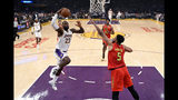 Los Angeles Lakers' LeBron James (23) drives to the basket against Atlanta Hawks' Jabari Parker (5) during the first half of an NBA basketball game, Sunday, Nov. 17, 2019, in Los Angeles. (AP Photo/Ringo H.W. Chiu)