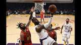 Los Angeles Lakers' LeBron James (23) shoots under pressure from Atlanta Hawks' DeAndre' Bembry during the first half of an NBA basketball game, Sunday, Nov. 17, 2019, in Los Angeles. (AP Photo/Ringo H.W. Chiu)