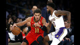 Atlanta Hawks' Trae Young (11) dribbles against Los Angeles Lakers' Troy Daniels (30) during the first half of an NBA basketball game, Sunday, Nov. 17, 2019, in Los Angeles. (AP Photo/Ringo H.W. Chiu)