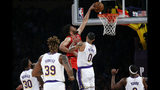 Atlanta Hawks' Jabari Parker (5) dunks against Los Angeles Lakers' Kyle Kuzma (0) during the first half of an NBA basketball game, Sunday, Nov. 17, 2019, in Los Angeles. (AP Photo/Ringo H.W. Chiu)