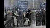 Police prepare to fire on protestors at the Hong Kong Polytechnic University in Hong Kong, Sunday, Nov. 17, 2019. (AP Photo/Achmad Ibrahim)