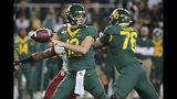 Baylor quarterback Charlie Brewer (12) passes during the first half of an NCAA college football game against Oklahoma in Waco, Texas, Saturday, Nov. 16, 2019. (AP Photo/Ray Carlin)