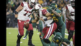 Oklahoma quarterback Jalen Hurts, center, is sacked by Baylor linebacker Blake Lynch, bottom, and Terrel Bernard, right, during the first half of an NCAA college football game in Waco, Texas, Saturday, Nov. 16, 2019. (AP Photo/Ray Carlin)