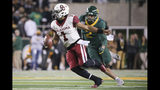 Oklahoma quarterback Jalen Hurts, left, is chased by Baylor linebacker Blake Lynch, right, during the first half of an NCAA college football game in Waco, Texas, Saturday, Nov. 16, 2019. (AP Photo/Ray Carlin)