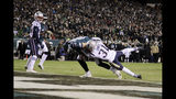 Philadelphia Eagles' Dallas Goedert (88) scores a touchdown against New England Patriots' Jonathan Jones (31) during the first half of an NFL football game, Sunday, Nov. 17, 2019, in Philadelphia. (AP Photo/Matt Rourke)