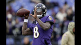 Baltimore Ravens quarterback Lamar Jackson works out prior to an NFL football game against the Houston Texans, Sunday, Nov. 17, 2019, in Baltimore. (AP Photo/Julio Cortez)