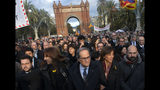 Catalan regional president Quim Torra, centre, walks to the Catalonia's high court in Barcelona, Spain, Monday, Nov.18, 2019. The pro-independence regional president of Catalonia is standing trial for allegedly disobeying Spain's electoral board by not removing pro-secession symbols from public buildings during an election campaign. (AP Photo/Joan Mateu)