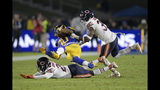 Los Angeles Rams running back Todd Gurley, middle, is tackled by Chicago Bears cornerback Prince Amukamara, bottom, and free safety Eddie Jackson during the second half of an NFL football game Sunday, Nov. 17, 2019, in Los Angeles. (AP Photo/Kyusung Gong)