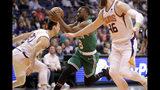Boston Celtics guard Kemba Walker (8) drives as Phoenix Suns forward Dario Saric and center Aron Baynes (46) defend during the first half of an NBA basketball game, Monday, Nov. 18, 2019, in Phoenix. (AP Photo/Matt York)