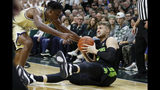 Michigan State guard Kyle Ahrens (0) looks to pass as Charleston Southern guard Phlandrous Fleming Jr. (24) reaches in during the first half of an NCAA college basketball game, Monday, Nov. 18, 2019, in East Lansing, Mich. (AP Photo/Carlos Osorio)