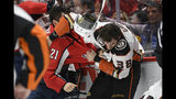 Washington Capitals right wing Garnet Hathaway (21) fights Anaheim Ducks center Derek Grant (38) during the second period of an NHL hockey game, Monday, Nov. 18, 2019, in Washington. (AP Photo/Nick Wass)