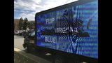 FILE - In this Nov. 5, 2019, file photo, a mobile billboard urges voters to cast ballots for Democrats outside Centreville High School in Clifton, Va. A re-election victory on Saturday, Nov. 16 by Louisiana Gov. John Bel Edwards has assured Democrats a place at the table when political maps are redrawn after the 2020 census. The recent Southern state elections provided a preview of the battle over redistricting power that is to come next year in many states. (AP Photo/Matthew Barakat, File)