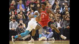 Charlotte Hornets guard Terry Rozier (3) protects the ball from Toronto Raptors forward OG Anunoby (3) during first half NBA action in Toronto on Monday, Nov. 18, 2019. (Frank Gunn/The Canadian Press via AP)