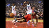 Toronto Raptors forward OG Anunoby (3) falls to the court as Charlotte Hornets guard Malik Monk (1) and forward Marvin Williams (2) look on during first half NBA action in Toronto on Monday, Nov. 18, 2019. (Frank Gunn/The Canadian Press via AP)