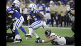 Indianapolis Colts' Marlon Mack (25) runs past dJacksonville Jaguars' Taven Bryan (90) during the second half of an NFL football game, Sunday, Nov. 17, 2019, in Indianapolis. (AP Photo/Michael Conroy)