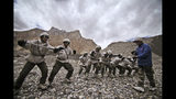 FILE- In this July 19, 2011 file photo, Indian army soldiers undergo a training session at the Siachen base camp, in Indian Kashmir on the border with Pakistan. The Indian army says an avalanche has hit one of its posts on a Himalayan glacier in disputed Kashmir region and that at least eight soldiers are trapped under snow. Army spokesman Lt. Col. Devender Anand says the avalanche struck on Monday in the northern part of the Siachen Glacier and that a search and rescue operation is underway. (AP Photo/Channi Anand, File)