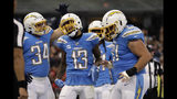 Los Angeles Chargers wide receiver Keenan Allen (13) reacts with teammates after scoring a touchdown during the second half of an NFL football game against the Kansas City Chiefs, Monday, Nov. 18, 2019, in Mexico City. (AP Photo/Marcio Jose Sanchez)