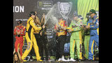 Kyle Busch, front left, celebrates with teammates in Victory Lane after winning a NASCAR Cup Series auto racing season championship on Sunday, Nov. 17, 2019, at Homestead-Miami Speedway in Homestead, Fla. (AP Photo/David Graham)