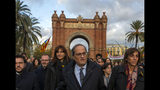 Catalan regional president Quim Torra, centre, arrives at the Catalonia's high court in Barcelona, Spain, Monday, Nov.18, 2019. The pro-independence regional president of Catalonia is standing trial for allegedly disobeying Spain's electoral board by not removing pro-secession symbols from public buildings during an election campaign. (AP Photo/Joan Mateu)