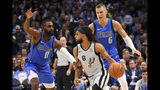 Dallas Mavericks guard Tim Hardaway Jr. (11) and Dallas Mavericks forward Kristaps Porzingis (6) guard as San Antonio Spurs guard Patty Mills (8) looks for an opening in the first half in an NBA basketball game Monday, Nov. 18, 2019, in Dallas. (AP Photo/Richard W. Rodriguez)
