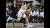 Ohio State's Duane Washington, left, brings the ball up court against Stetson's Kenny Aninye during the first half of an NCAA college basketball game Monday, Nov. 18, 2019, in Columbus, Ohio. (AP Photo/Jay LaPrete)