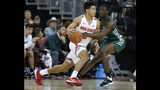 Ohio State's D.J. Carton, left, tries to dribble past Stetson's Rob Perry during the first half of an NCAA college basketball game Monday, Nov. 18, 2019, in Columbus, Ohio. (AP Photo/Jay LaPrete)
