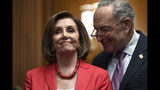 House Speaker Nancy Pelosi of Calif., left, and Senate Minority Leader Sen. Chuck Schumer of N.Y., right, listen as they wait to speak at an event on Capitol Hill in Washington, Tuesday, Nov. 12, 2019, regarding the earlier oral arguments before the Supreme Court in the case of President Trump's decision to end the Obama-era, Deferred Action for Childhood Arrivals (DACA), program. (AP Photo/Susan Walsh)