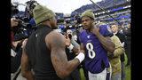 Houston Texans quarterback Deshaun Watson, left, shakes hands with Baltimore Ravens quarterback Lamar Jackson after an NFL football game, Sunday, Nov. 17, 2019, in Baltimore. The Ravens won 41-7. (AP Photo/Nick Wass)