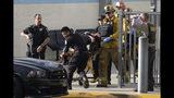 Emergency personnel remove an injured person following a shooting at Saugus High School, Thursday, Nov. 14, 2015 in Santa Clarita, Calif. (David Crane/The Orange County Register via AP)