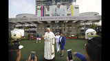 Nurses of St.Louis hospital get themselves photographed with a life size statue of Pope Francis in Bangkok, Thailand, Tuesday, Nov. 19, 2019. Pope Francis arrives in Thailand on Wednesday for the first visit here by the head of the Roman Catholic Church since St. John Paul II in 1984. (AP Photo/Manish Swarup)