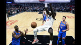 Los Angeles Clippers' Montrezl Harrell (5) dunks against the Oklahoma City Thunder during the first half of an NBA basketball game, Monday, Nov. 18, 2019, in Los Angeles. (AP Photo/Ringo H.W. Chiu)