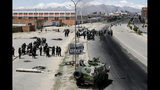 Security forces guard the state-own Senkata filling gas plant in El Alto, on the outskirts of La Paz, Bolivia, Tuesday, Nov. 19, 2019. Backers of former President Evo Morales have taken to the streets asking for his return since he resigned on Nov. 10 under pressure from the military after weeks of protests against him over a disputed election he claim to have won. (AP Photo/Natacha Pisarenko)