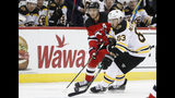 Boston Bruins center Brad Marchand (63) controls the puck in front of New Jersey Devils center Travis Zajac (19) during the first period of an NHL hockey game Tuesday, Nov. 19, 2019, in Newark, N.J. (AP Photo/Kathy Willens)
