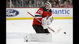 New Jersey Devils goaltender Mackenzie Blackwood (29) makes a save during the first period of the team's NHL hockey game against the Boston Bruins, Tuesday, Nov. 19, 2019, in Newark, N.J. (AP Photo/Kathy Willens)