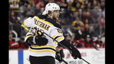 Boston Bruins right wing David Pastrnak (88) celebrates with center Brad Marchand after scoring during the first period of the teams NHL hockey game against the New Jersey Devils, Tuesday, Nov. 19, 2019, in Newark, N.J. (AP Photo/Kathy Willens)