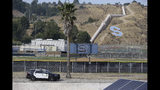 A Los Angeles Sheriff Sheriff's vehicle patrols the surroundings of the Saugus High School in Santa Clarita, Calif., Friday, Nov. 15, 2019. Investigators said Friday they have yet to find a diary, manifesto or note that would explain why a boy killed two students outside the Southern California high school on his 16th birthday. (AP Photo/Damian Dovarganes)