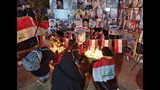 People light candles for slain protesters in Tahrir Square, in Baghdad, Iraq, Monday, Nov. 18, 2019. (AP Photo/Hadi Mizban)