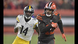 Cleveland Browns strong safety Morgan Burnett (42) returns an interception as Pittsburgh Steelers wide receiver Tevin Jones pursues during the first half of an NFL football game Thursday, Nov. 14, 2019, in Cleveland. (AP Photo/David Richard)
