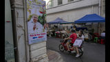 A poster of Pope Francis is displayed in a street corner in Bangkok, Thailand, Wednesday, Nov. 20, 2019. Pope Francis arrives in Thailand on Wednesday for the first visit here by the head of the Roman Catholic Church since St. John Paul II in 1984. (AP Photo/Gemunu Amarasinghe)