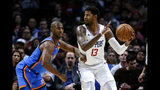 Los Angeles Clippers' Paul George (13) is defended by Oklahoma City Thunder's Chris Paul (3) during the second half of an NBA basketball game, Monday, Nov. 18, 2019, in Los Angeles. The Clippers won 90-88. (AP Photo/Ringo H.W. Chiu)