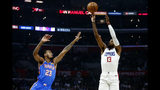 Los Angeles Clippers' Paul George (13) shoots against Oklahoma City Thunder's Terrance Ferguson (23) during the first half of an NBA basketball game, Monday, Nov. 18, 2019, in Los Angeles. (AP Photo/Ringo H.W. Chiu)