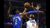 Los Angeles Clippers' Terance Mann (14) shoots under pressure from Oklahoma City Thunder's Shai Gilgeous-Alexander (2) during the first half of an NBA basketball game, Monday, Nov. 18, 2019, in Los Angeles. (AP Photo/Ringo H.W. Chiu)